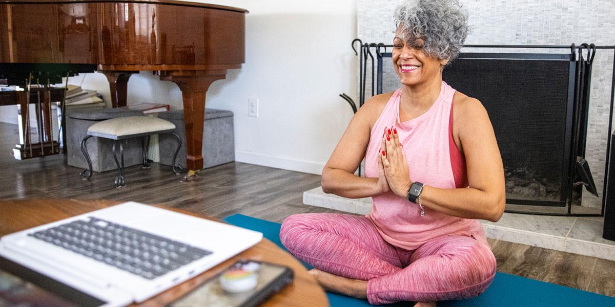 Yoga North ISYI Woman enjoying on demand online class